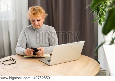 Senior Woman Shopping On Internet, Paying With Credit Card