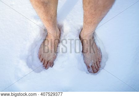 Overhead View Of Senior Man On Snow Outdoors, Closeup Of Feet. Unrecognizable Barefoot Guy Developin