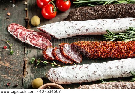 Fuets Catalan Dry Sausages. Set Of Spanish Sausages And Dry Cured Meat Chistorra, Chorizo, Salchicho