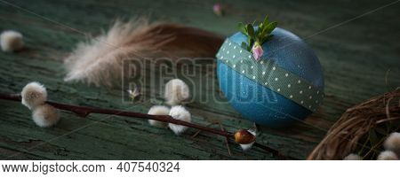 Blue Easter Egg On Old Weathered Wood. Easter Decoration In Country Stil With Short Depth Of Field.