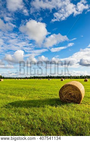 Vertical Photo Of Hay Ball Giving Strong Shadow At Nordic Summer Late Evening When Sun Is Low, But S