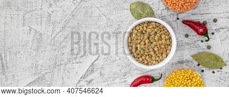 Banner With Three Varieties Of Lentils Photographed From Above. Lentils In White Plate On White Ston