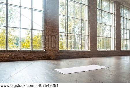 White Mat On Wooden Floor Empty Modern Spacious Gym Private Fitness Classroom Sport Club Studio Clas