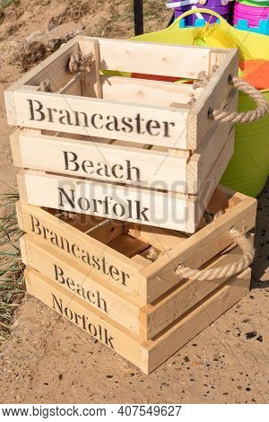 Wooden Beach Crates At Brancaster Beach On A Sunny Day, North Norfolk England