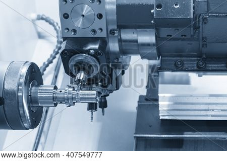 The Turn-mill Machine Cutting The Metal Shaft Part. The Hi-precision Manufacturing Process By Multi-