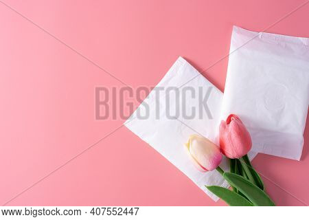 Sanitary Pad, Sanitary Napkin With Tulip Flower On Pink Background. Menstruation, Feminine Hygiene,