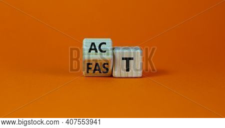 Time To Act Fast Symbol. Turned A Wooden Cube With Words 'act Fast'. Beautiful Orange Table, Orange