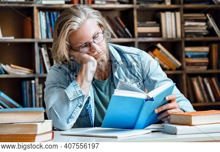 Sleepy Tired Young Male Highschool Student Teacher Man Hipster Author Glasses Head On Hand Read Book