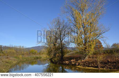 The Stream Torrente Malina In The Autumn Landscape Near The Village Of Moimacco Close To Cividale De