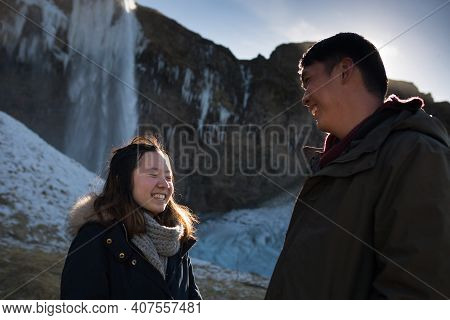 Hauyfoss Waterfall, Iceland - 03.11.2018: Love And Happiness Concept. Close Up Portrait Of Happy Asi