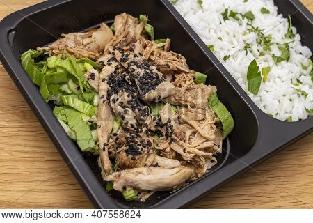 Close Up View Of Shredded Chicken With Rice, Takeaway Food, Healthy Diet. Food In A Box