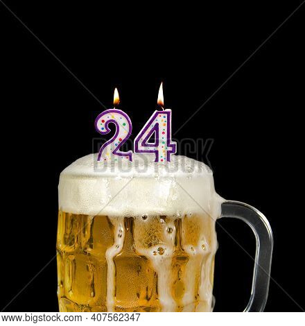 Number 24 Candle In Beer Mug For Birthday Celebration Isolated On Black