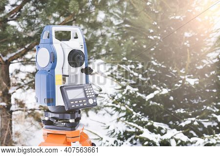 Electronic Total Station In Winter, A Tool For Performing Geodetic, Construction And Cadastral Works
