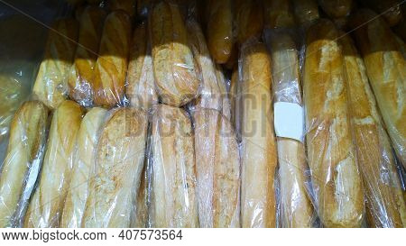 Hot Fresh Wheat Long Loaf On Supermarket Shelf. Natural Bakery Products. Self-service Basis. Concept