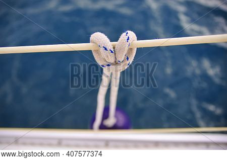 Nautical Knot Close Up. Sailing Concept. Hanging Fender Of The Sailing Boat