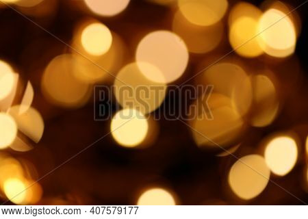 Wallpaper Shining Glitter.gold Glitter Background With Shining Bokeh On A Black Background. Shining