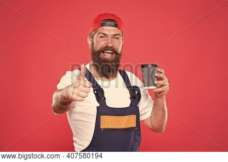 Builder Enjoy Coffee. Handsome Builder Hold Coffee Cup. Man Protective Uniform. Coffee Helps Enhance