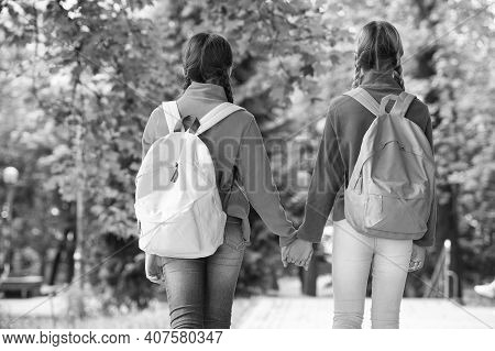 Girls Backpackers Friends Fleece Clothes Backpacks Forest Background, Hand In Hand Concept.