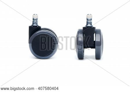Two Furniture Castor Wheel For Office Chair Isolated On White Background. Close-up View.