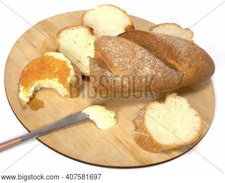 Fresh Baguettes With Crispy Crust Chopped On A Cutting Board