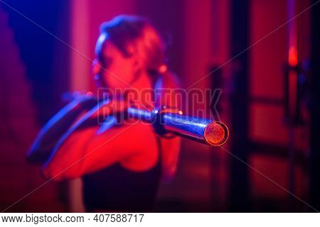 Sports Woman With Barbell. Fit Young Woman Lifting Barbells, Working Out In A Gym. Fit Girl Doing Sq