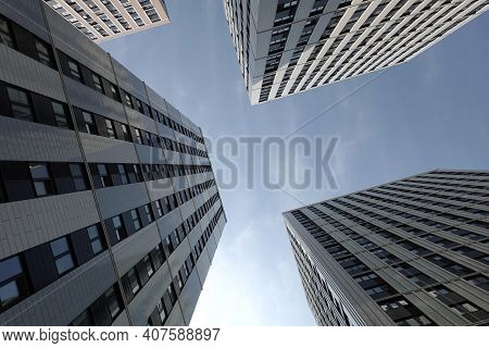 High Bottom Up Perspective View Of Modern City Tower Buildings With Many Windows In The Urban Cluste