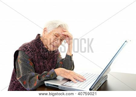 Elderly woman in a uneasy look
