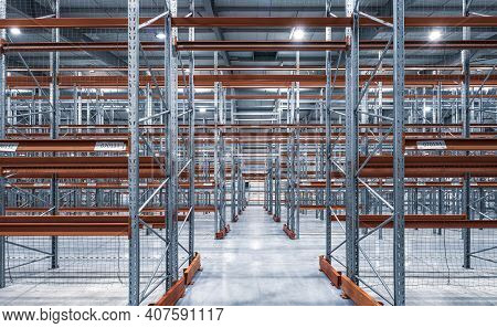 Interior Of Huge Empty Storehouse. Industrial Warehouse Racking.