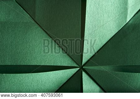 Abstract Radial Green Background Of Folded Textured Paper. Close-up Image. Concepts: Origami, Color,