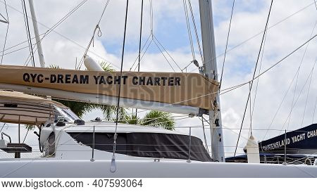 Airlie Beach, Queensland, Australia - February 2021: Qyc Dream Yacht Charter Moored In The Marina -