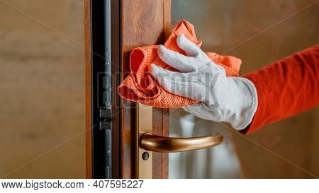 Cleaning Front Door Handle By Antibacterial Alcohol Detergent. Woman Houseworker In White Gloves Cle