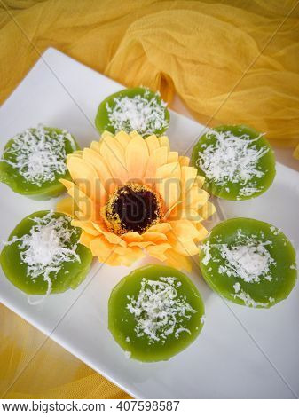 Steamed Pandan Rice Cake Or Locally Known As Kuih Lompang Or Kuih Kasui With Desiccated Coconut On T