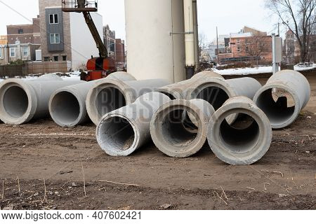Concrete Drainage Pipe Construction Stacked At Roadsides For Industrial Building Ditty