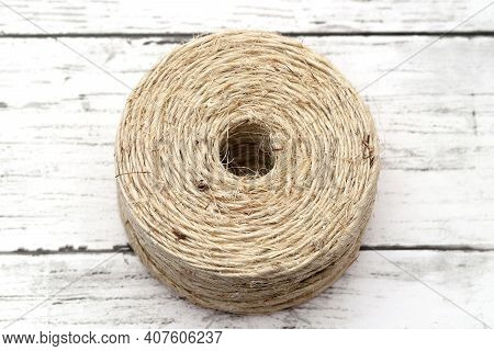 Close Up Of Clew Of Linen Twine On White Grunge Wooden Table