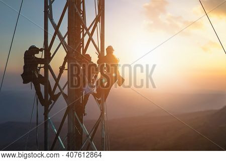 Silhouette Electrician Work On High Ground Heavy Industry Concept. Construction Of The Extension Of