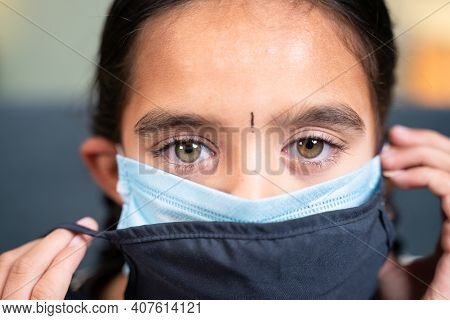 Close Up Head Shot Of Girl Wearing Double Or Two Face Mask To Protect From Coronavirus Or Covid-19 O
