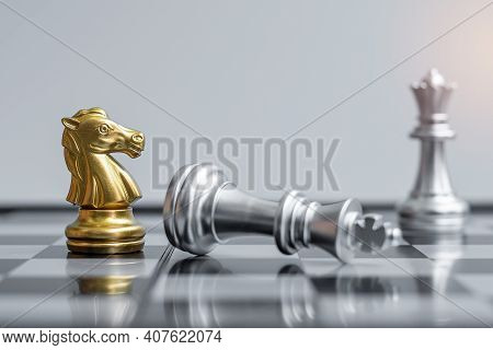 Gold Chess Knight Figure Stand Out From Crowd Of Enermy Or Opponent During Chessboard Competition. S