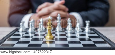 Chess King Figure Against Chessboard Opponent With Businessman Manager Background. Strategy, Success