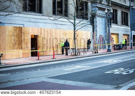 Portland, Oregon Usa - Feb. 10, 2021\ncity Blocks Of Businesses Currently Boarded Up And Barricaded