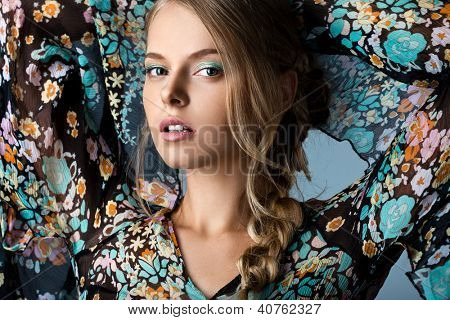 beautiful woman in many-colored blouse