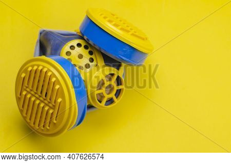 Respirator Type Half Mask With Replaceable Filters On Yellow Background. A Special Means Of Personal