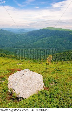 Carpathian Summer Mountain Landscape. Beautiful Countryside With Rock On The Grassy Hill. View In To