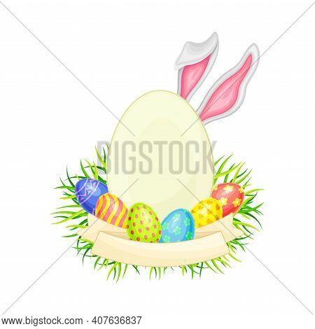 Oval Frame With Peeped Out Bunny Ears And Decorated Easter Eggs Or Paschal Eggs Rested In Green Gras