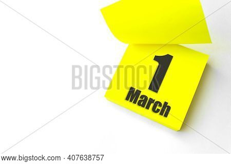 March 1st . Day 1 Of Month, Calendar Date. Close-up Blank Yellow Paper Reminder Sticky Note On White