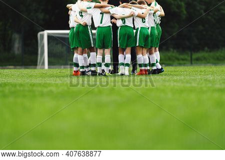 Youth Soccer Club. Boys Huddling In Football Team. Team Sports Coach Giving Pregame Speech To Group