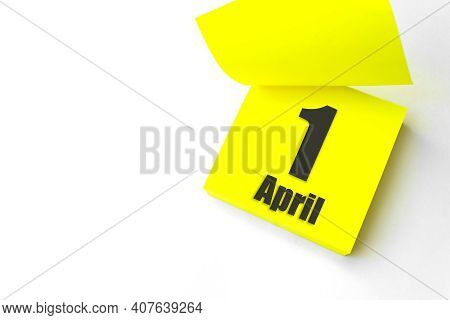 April 1st . Day 1 Of Month, Calendar Date. Close-up Blank Yellow Paper Reminder Sticky Note On White