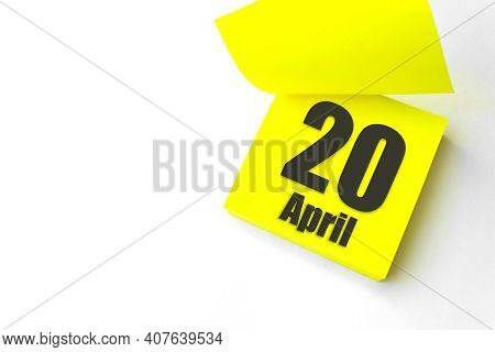 April 20th. Day 20 Of Month, Calendar Date. Close-up Blank Yellow Paper Reminder Sticky Note On Whit