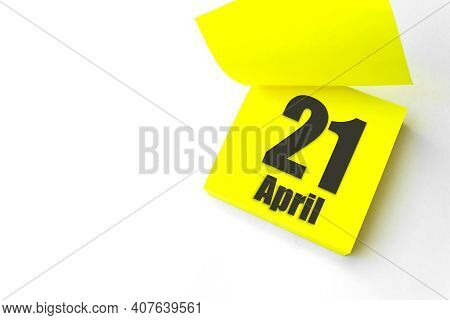 April 21st . Day 21 Of Month, Calendar Date. Close-up Blank Yellow Paper Reminder Sticky Note On Whi