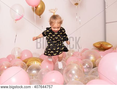 Child Birthday Party Celebration, Pink And Gold Balloons All Around, Happy Cute Little Caucasian Bab