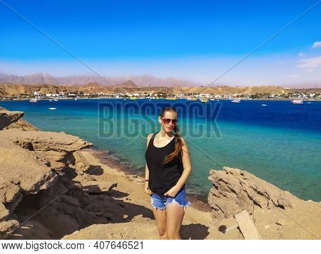 A Female Tourist Poses Among The Rocks On The Shores Of Sharm El Maya Bay In Sharm El Sheikh (egypt)